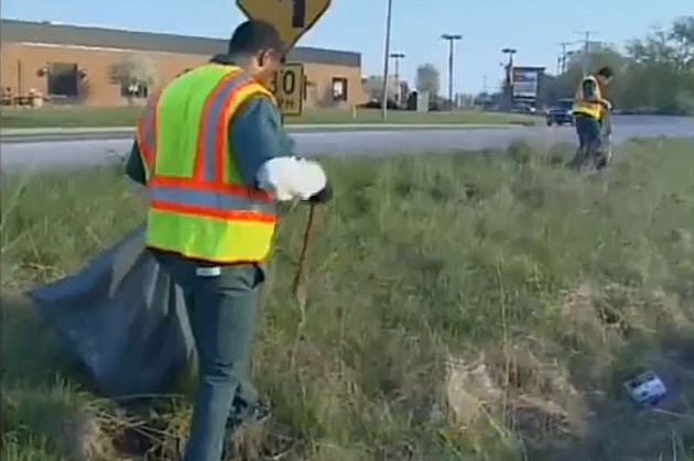 inmates picking up trash